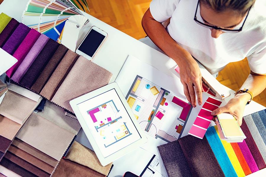 Interior Designer Insurance - Interior Designer Looking at Samples and Sketches for a Design