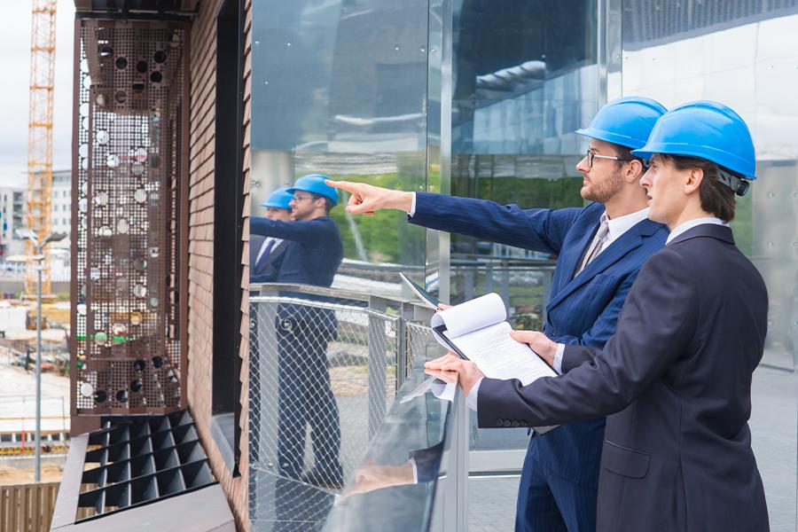 Real Estate Developer Insurance - Real Estate Developers in Helmets at Development Site